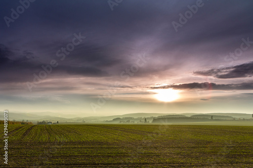 View of the Ore Mountains in autuum, foggy meadow in the background and forests, Wallpaper Mural