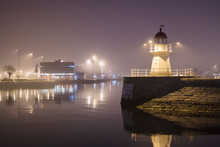 Lighthouse At Harbor Entrance In Malmo, Sweden At Night