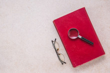 Old Book, Magnifying Glass And...