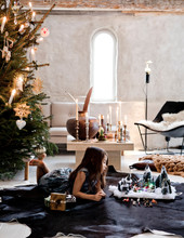 Girl Lying By Nativity Scene A...