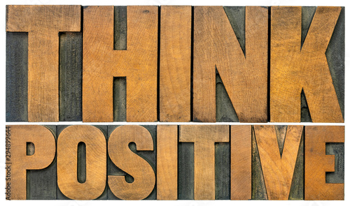 Fotomural Think positive word abstract in wood type