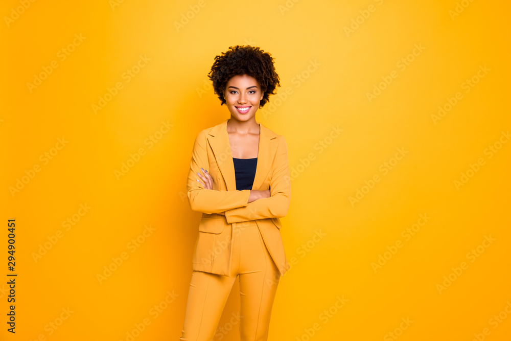 Fototapeta Portrait of her she nice-looking attractive lovely content cheerful cheery wavy-haired girl folded arms spring clothing trend isolated over bright vivid shine vibrant yellow color background
