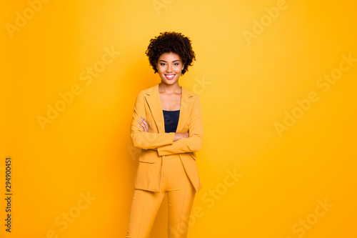 obraz lub plakat Portrait of her she nice-looking attractive lovely content cheerful cheery wavy-haired girl folded arms spring clothing trend isolated over bright vivid shine vibrant yellow color background