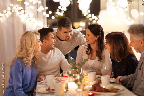 Fototapety, obrazy: celebration, holidays and people concept - happy family having tea party at home