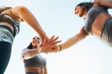 Three Happy Sporty Women Stack...