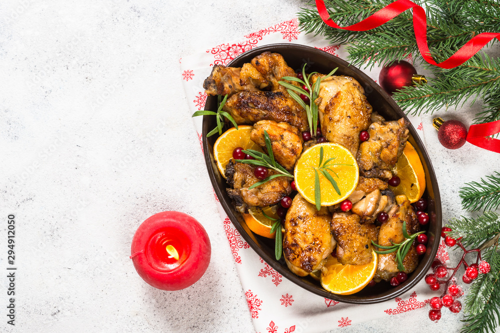 Fototapety, obrazy: Christmas food - roasted chicken with orange on white table.