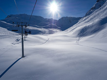 France. January, 2018: Ski Lift And Ski Slope With Skiers Under It On Sunny Winter Day With Blue Sky. Alpine Resort Meribel, Europe