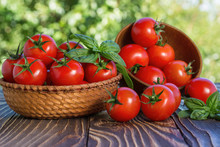 Cherry Tomatoes And Basil On Wooden Board Outdoors