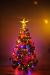 canvas print picture Christmas tree with festive lights, orange background