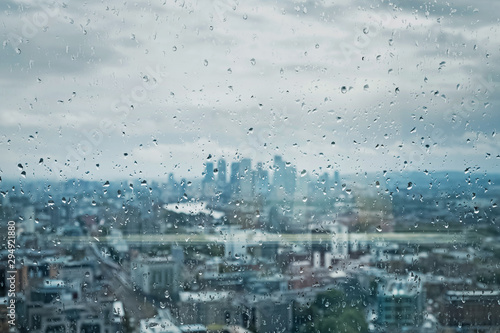 Drops of rain on the glass on the background of London city.