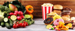 Leinwanddruck Bild - healthy or unhealthy food. Concept photo of healthy and unhealthy food. Fruits and vegetables vs donuts and fast food