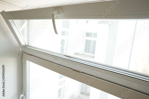 white glass pane open for ventilation on a white background close-up Wallpaper Mural