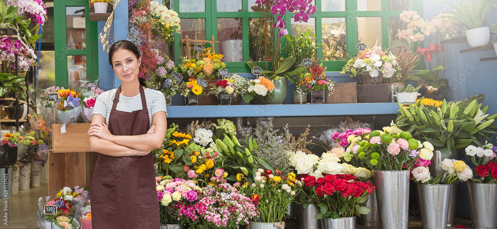 Fototapeta Startup successful sme small business entrepreneur owner asian woman standing with flowers at florist shop. Portrait of caucasian girl successful owner environment friendly concept banner