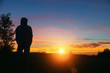 canvas print picture - Man watching the beautiful sunset landscape