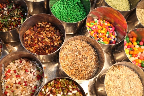 Overhead shot of India street food snacks and candies in silver pots Canvas Print