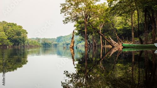 Photo Boat in the fog of the Amazon rainforest