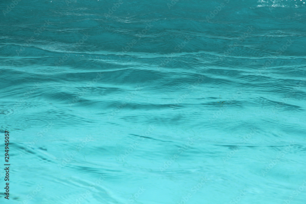Fototapety, obrazy: Blue pool water reflecting sun rippled details.surface of blue pool, bottom of water in swimming pool