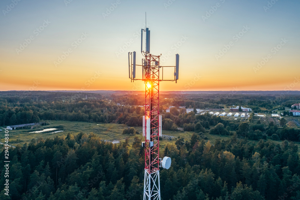 Fototapeta Mobile communication tower during sunset from above.