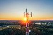 canvas print picture - Mobile communication tower during sunset from above.