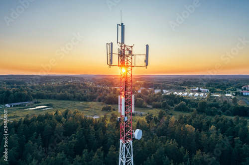 Mobile communication tower during sunset from above. Wallpaper Mural