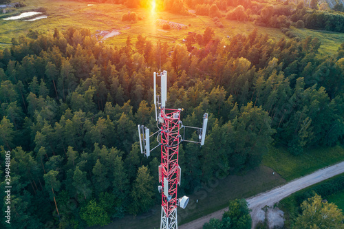 Canvas Print Mobile communication tower during sunset from above.