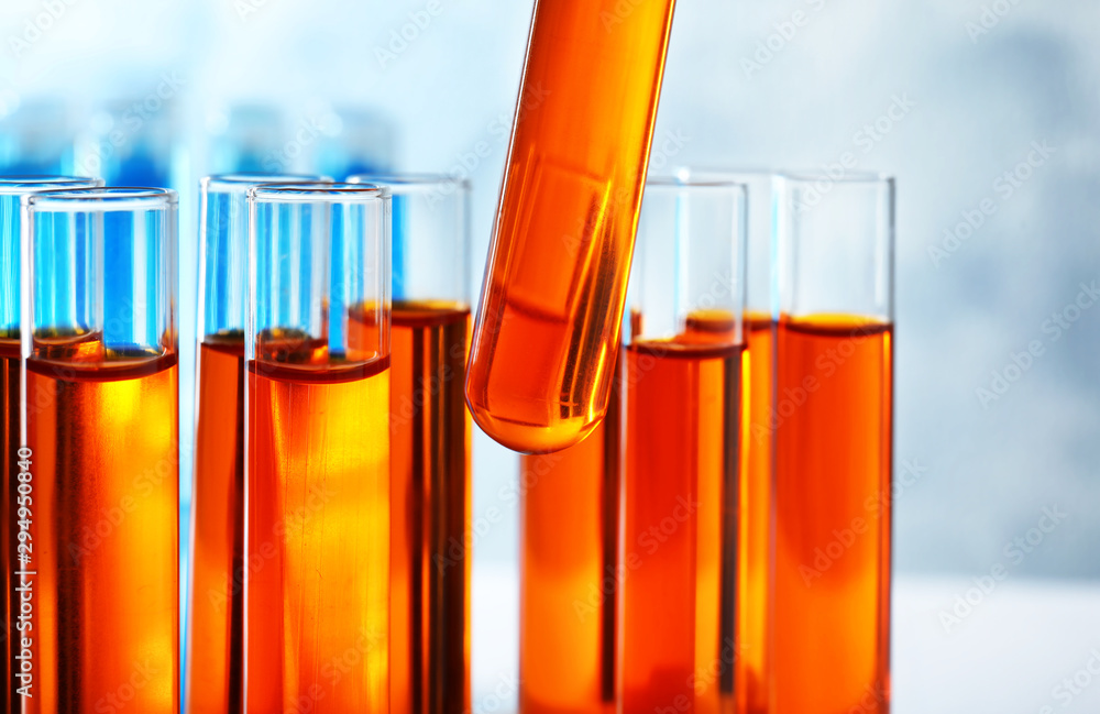 Fototapeta Taking test tube with liquid sample, closeup