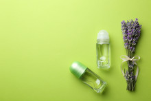 Female Deodorants And Lavender Flowers On Green Background, Flat Lay. Space For Text