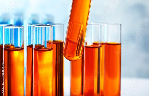 Photo Taking test tube with liquid sample, closeup