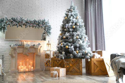 Valokuvatapetti Stylish interior with decorated Christmas tree in living room