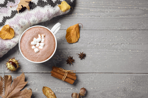 Foto auf Leinwand Schokolade Flat lay composition with cup of hot drink on grey wooden table, space for text. Cozy autumn atmosphere