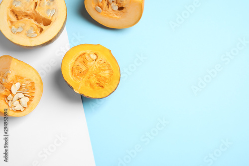 Fototapeta Fresh ripe pumpkins on color background, flat lay with space for text. Holiday decoration obraz