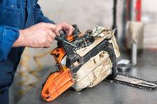 Mechanic Repairing A Chainsaw....