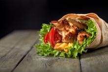Chicken Fajita Wrap Sandwich. Sandwich With Fajita Chicken. Roll With Chicken Meat Fresh Tomatoes And Cucumbers, Lettuce Wrapped In Bread Pita.