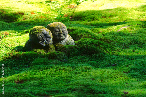 Leinwand Poster  The moss garden and stone statues in the Sanzenin temple, Ohara, Kyoto, Japan