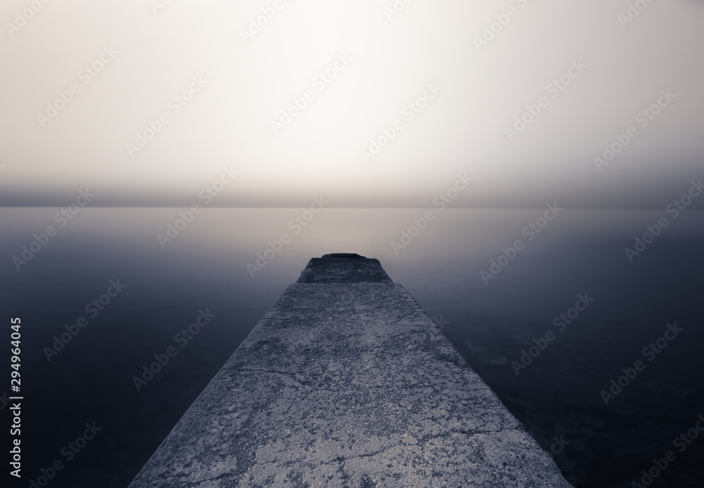 Fototapeta Perspective Cement pier with beautiful sea nature background. Abstract long exposure photography gradient wallpaper advertise. Concept desktop relax