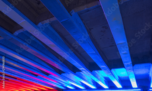 Bridge with neon blue and red lights underneath