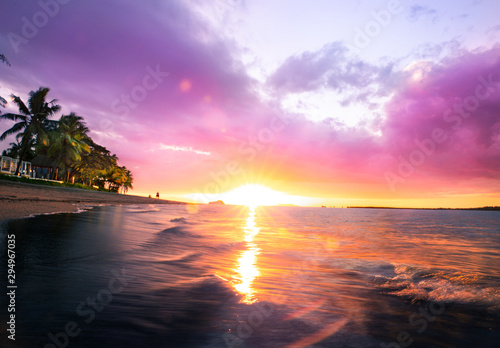 Fototapeta Tropical Fiji sunset on the beach of Sofitel obraz