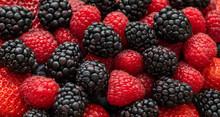 Berry Background. Blackberries, Raspberries And Strawberries Closeup, Macro. Food Background. Sweet Fresh Ripe Berries Mix. Berry Pattern And Texture.