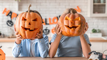 Two Little Kids Celebrating Halloween At Home Kitchen