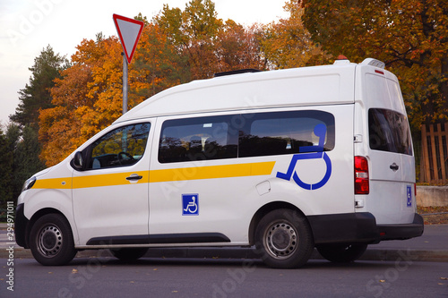 Vászonkép Minibus for disabled passengers with disability signs