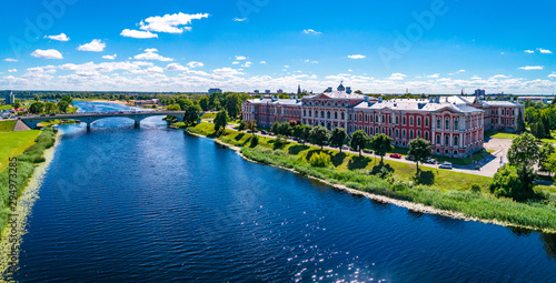 Foto op Plexiglas Oude gebouw Panoramic view over city Jelgava, Lielupe river and ''Latvia University of Agriculture'' during sunny summer day.