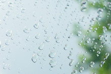 Water Drops On Glass Green Bac...