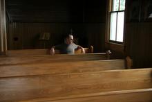 Man Sitting In Vintage Church ...