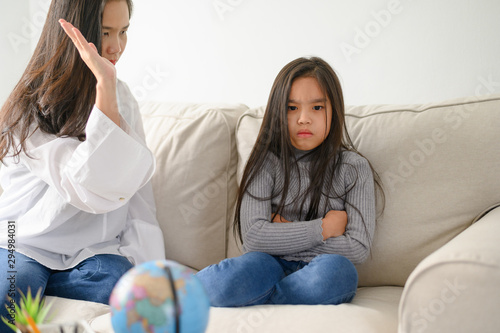 Fotografie, Tablou  Angry asian mother sitting with little daughter , mom scolds for discipline bad