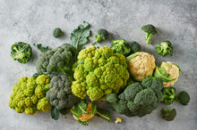 Fresh Green Cabbage, Cauliflower And Broccoli On A Light Textured Background.