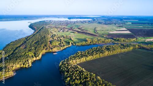 Foto op Aluminium Khaki Flying over the beautiful spring river. Aerial camera shot. Ukraine.