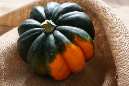 Photo Squash. Fresh, organic Acorn Squash close up on rustic background