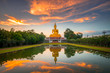 Leinwanddruck Bild - Beautiful Big Golden Buddha statue sunset sky in Thailand temple,khueang nai District, Ubon Ratchathani province, Thailand.Amazing Buddha image with sunny sky clouds.