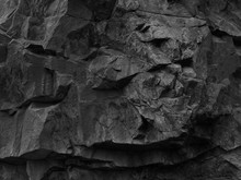 Rock Texture. Dark Black Grunge Stone Texture Background. Fragment Of A Mountain Close-up.