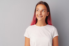 Young Girl Teenager With Pink Hair Happy And Smiling Over Gray Background